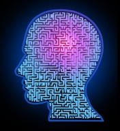 Human intelligence puzzle represented by a blue glowing maze and labyrinth in the shape of a human head representing the concept and symbol of the complexity of brain thinking and thought patterns as a challenging problem to solve by medical doctors.